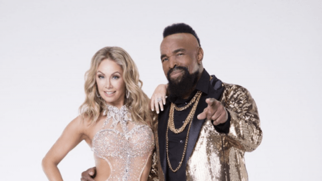 Kym Johnson and Mr. T standing together in front of a gray background.