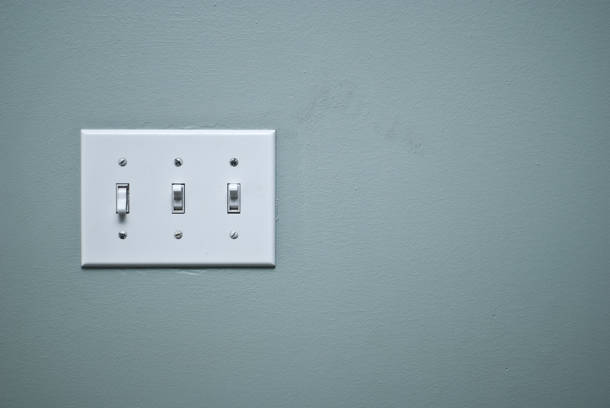 Light switch on a gray wall