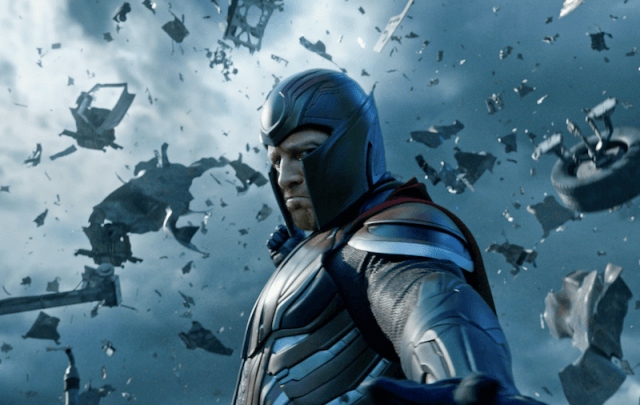 Magneto stands in front of rubble being blasted into the sky.