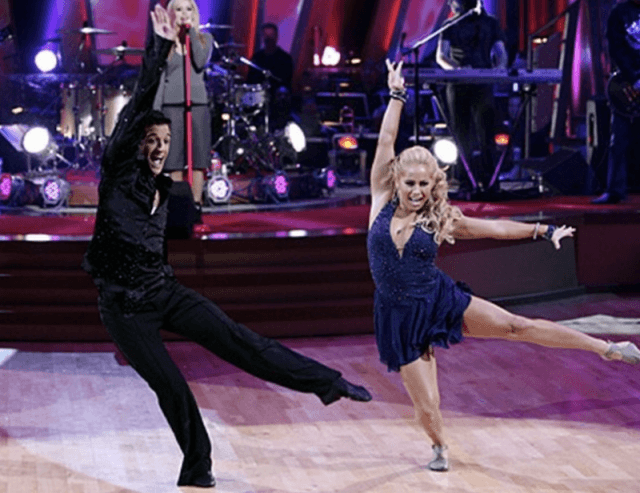 Mark Ballas and Sabrina Bryan performing on the dance floor.