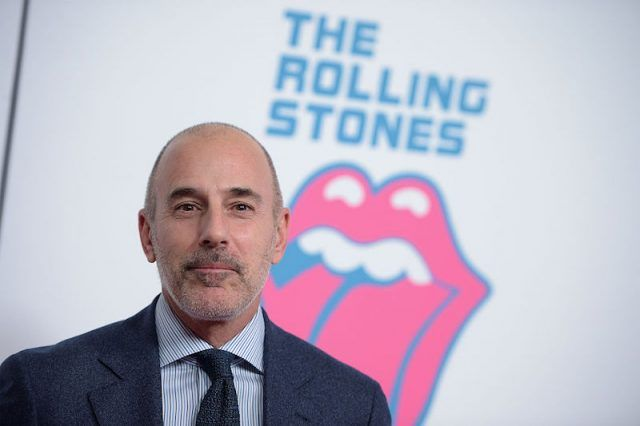 Matt Lauer standing in front of a Rolling Stones sign while starting straight ahead.