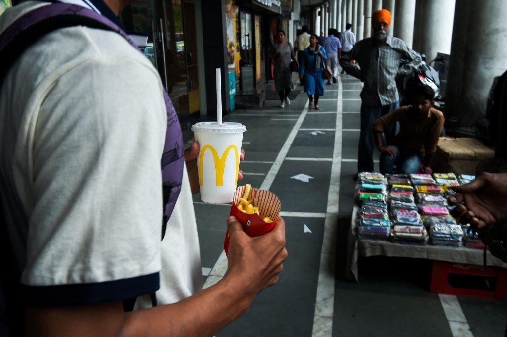 Man carrying a McDonald's meal