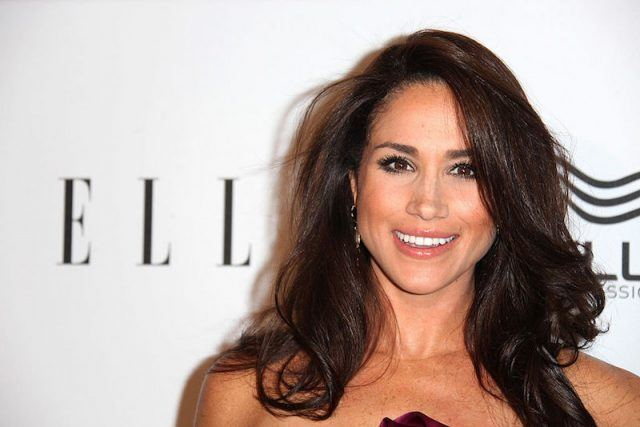 Meghan Markle smiles at at the ELLE Women in Television Awards.