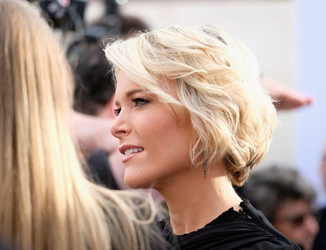 Megyn Kelly speaking to guests at an event.