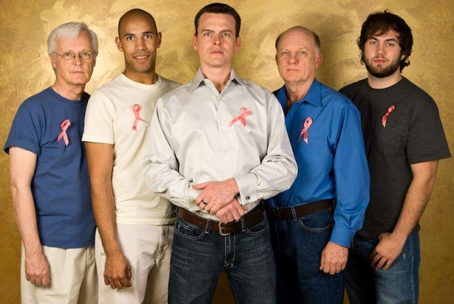 A group of men wearing pink ribbons.