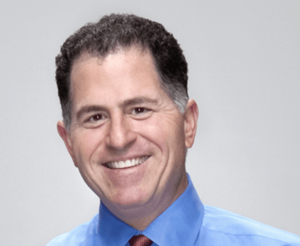 Michael Dell smiles in a headshot wearing a blue shirt and red tie.