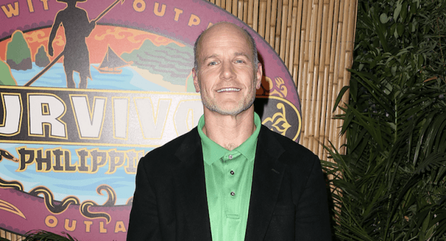 Michael Skupin posing for photos on the Survivor Reunion red carpet.