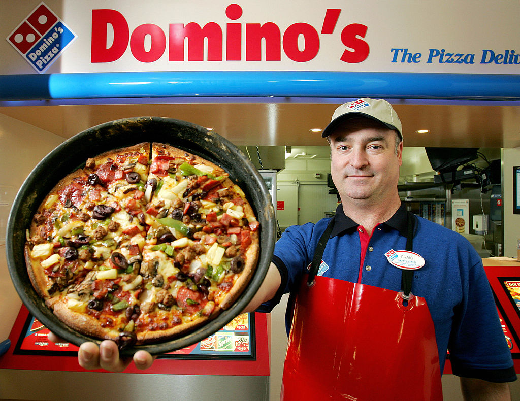 Craig Birchall, a Domino's Pizza franchisee, displays his super supreme pizza.