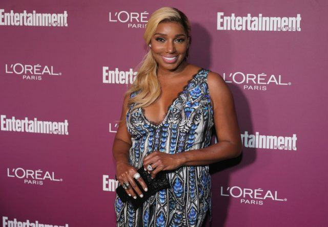 NeNe Leakes posing on a red carpet.