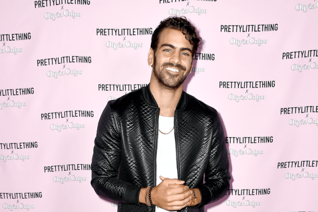 Nyle DiMarco poses in a leather jacket for a fashion launch in Los Angeles.