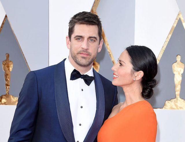 Aaron Rodgers and Olivia Munn posing at the 88th Annual Academy Awards.