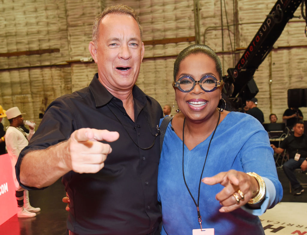 Tom Hanks and Oprah Winfrey in hand