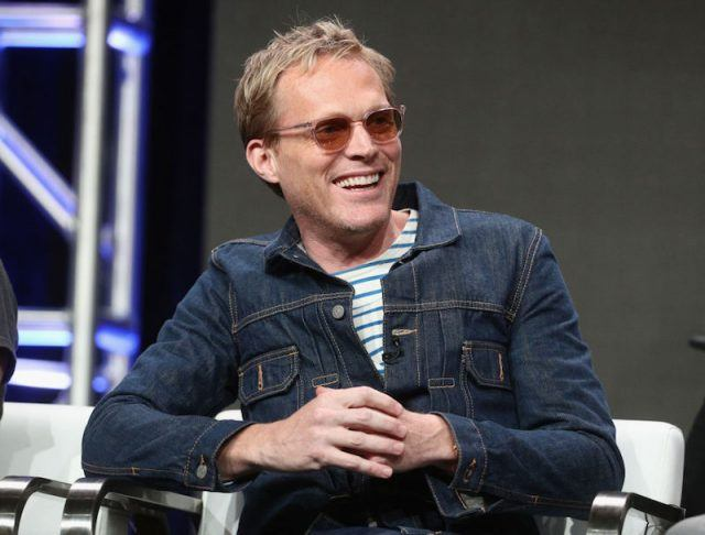 Paul Bettany sits down and smiles during the Television Critics Association Press Tour .