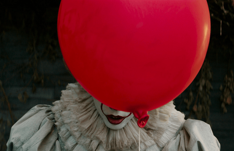 Pennywise behind the iconic red balloon