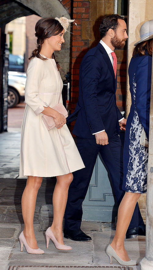Kate Middleton walks with a crowd of people.