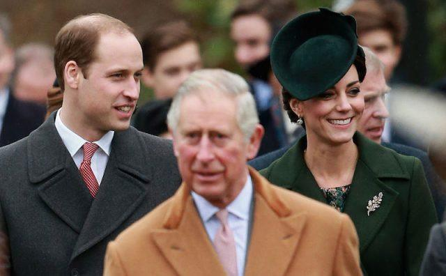 Prince William walks with Kate Middleton behind Prince Charles.