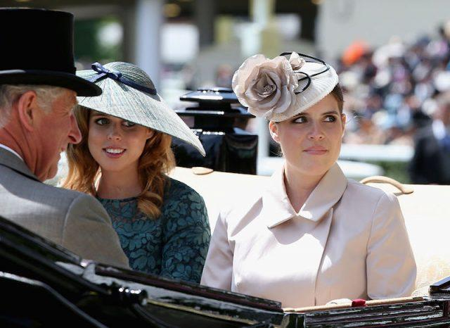 Prince Charles rides in a carriage with his two nieces.