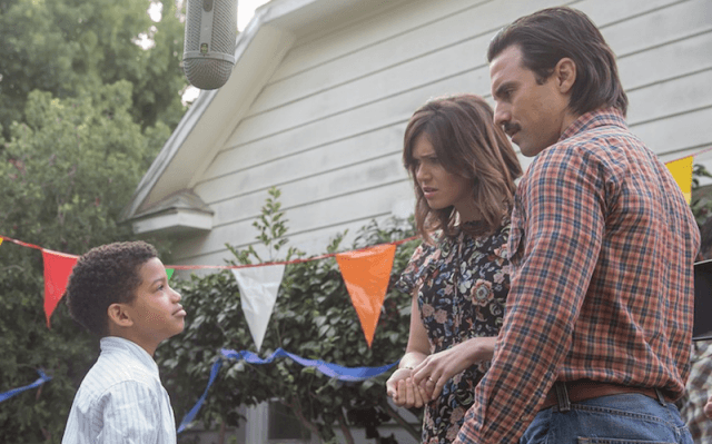 Jack and Rebecca talk to a boy at an outdoor party.