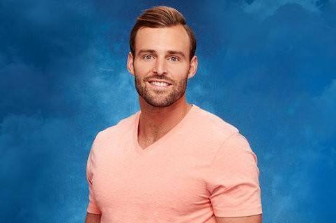 Robby Hayes smiling in his headshot in front of a blue background.