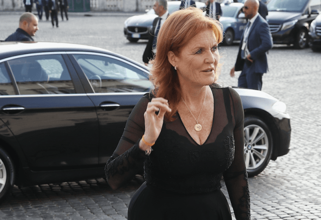 Sarah Ferguson walking out of a black car.