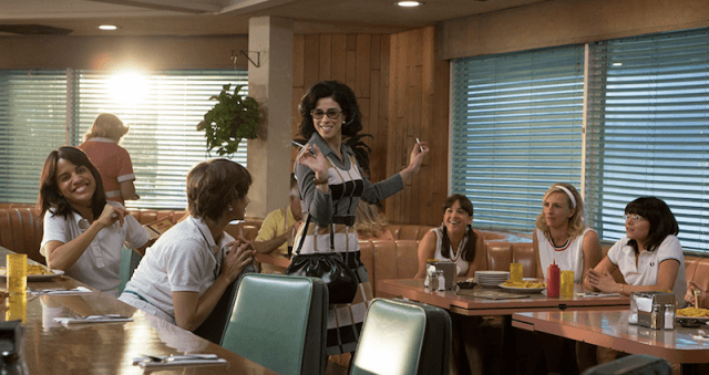 Sarah Silverman's Gladys talking to a group of women in a diner.