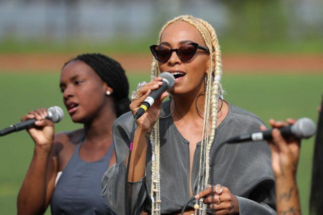 Solange Knowles singing into a microphone.