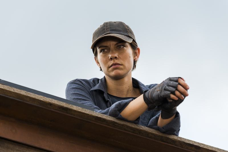 Maggie Greene leans over a wall in The Walking Dead