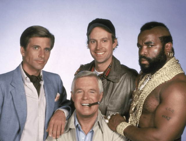 The A-Team characters smiling and posing together for group shot.