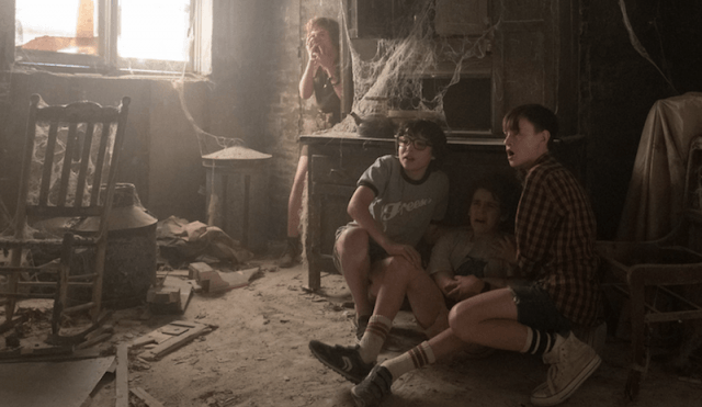 The gang looks fearful and scared in the abandoned house.