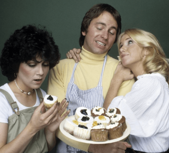 Janet, Chrissy and Jack stand together as Chrissy hugs Jack and Janet inspects a cupcake.