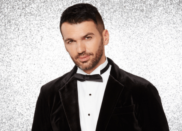 Tony Dovolani poses in a tux