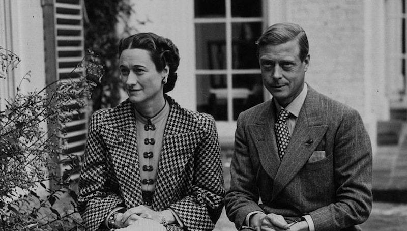 A black and white photo of Wallis Simpson and Edward VIII sitting side by side