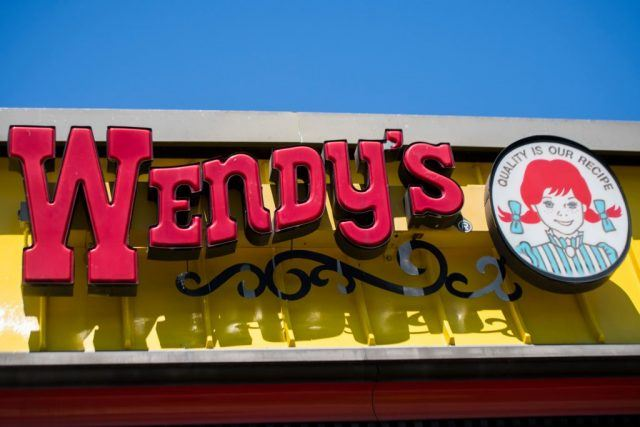 The Wendy's sign seen doing a bright blue day.