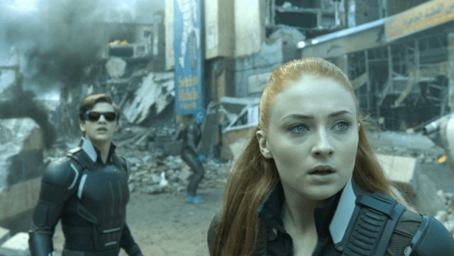 Jean Grey and Cyclops look ahead in shock while smoke billows behind them