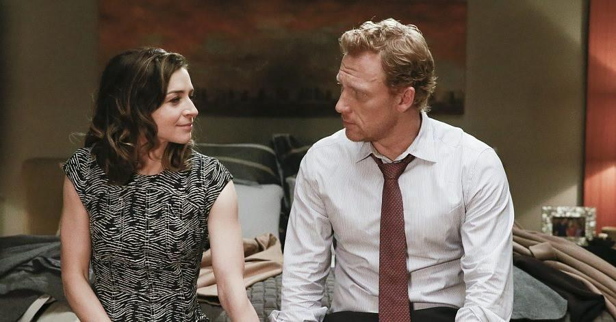 Amelia and Owen sitting on a bed together on Grey's Anatomy