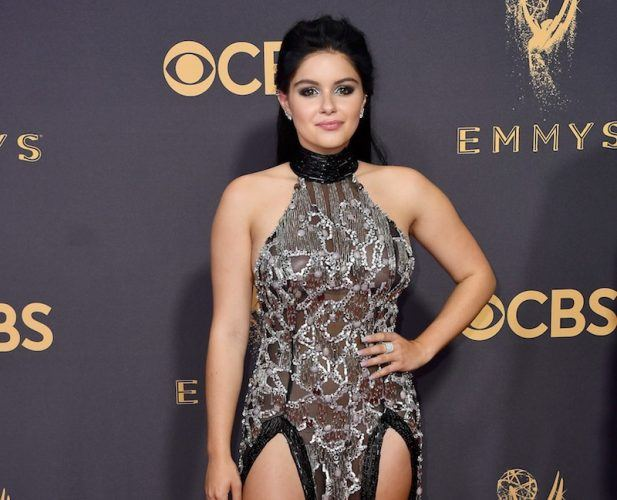 Ariel Winter poses at the 2017 Emmys in a high slit dress.