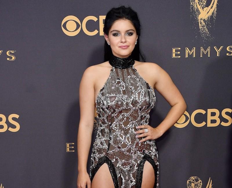 Ariel Winter poses at the 2017 Emmys in a high slit dress
