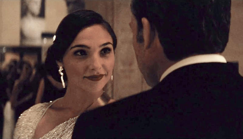 Diana Prince stares at Bruce Wayne in Batman v Superman: Dawn of Justice