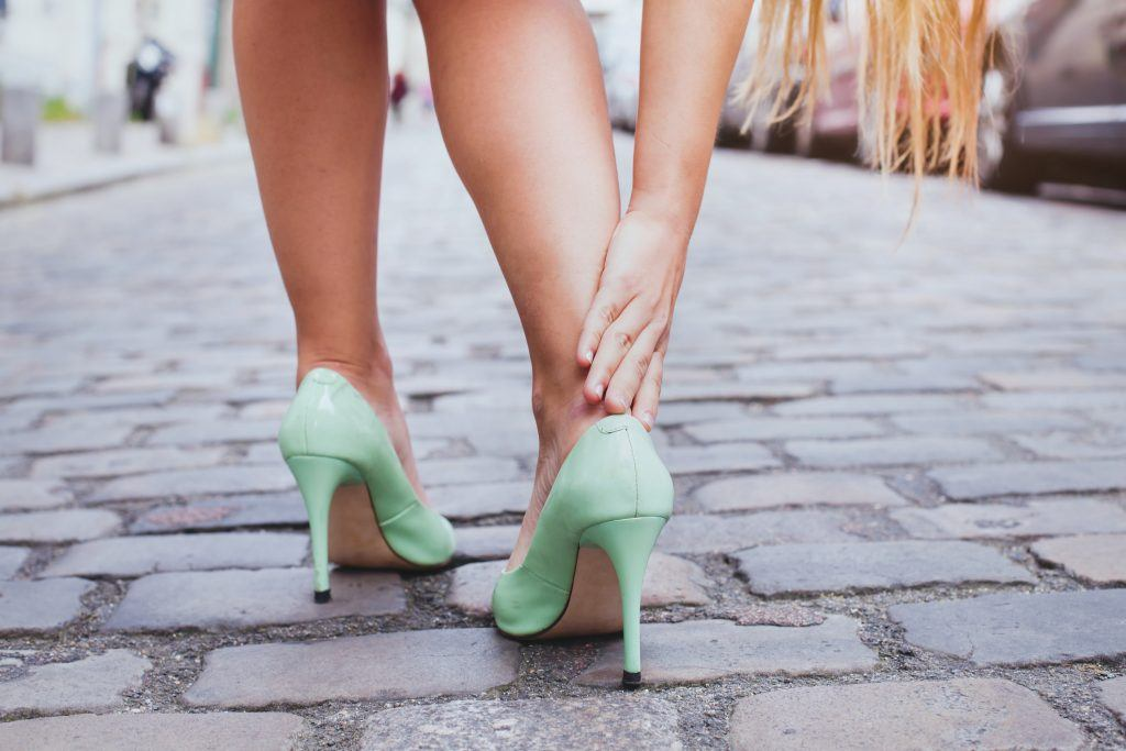 Woman with painful feet in heels