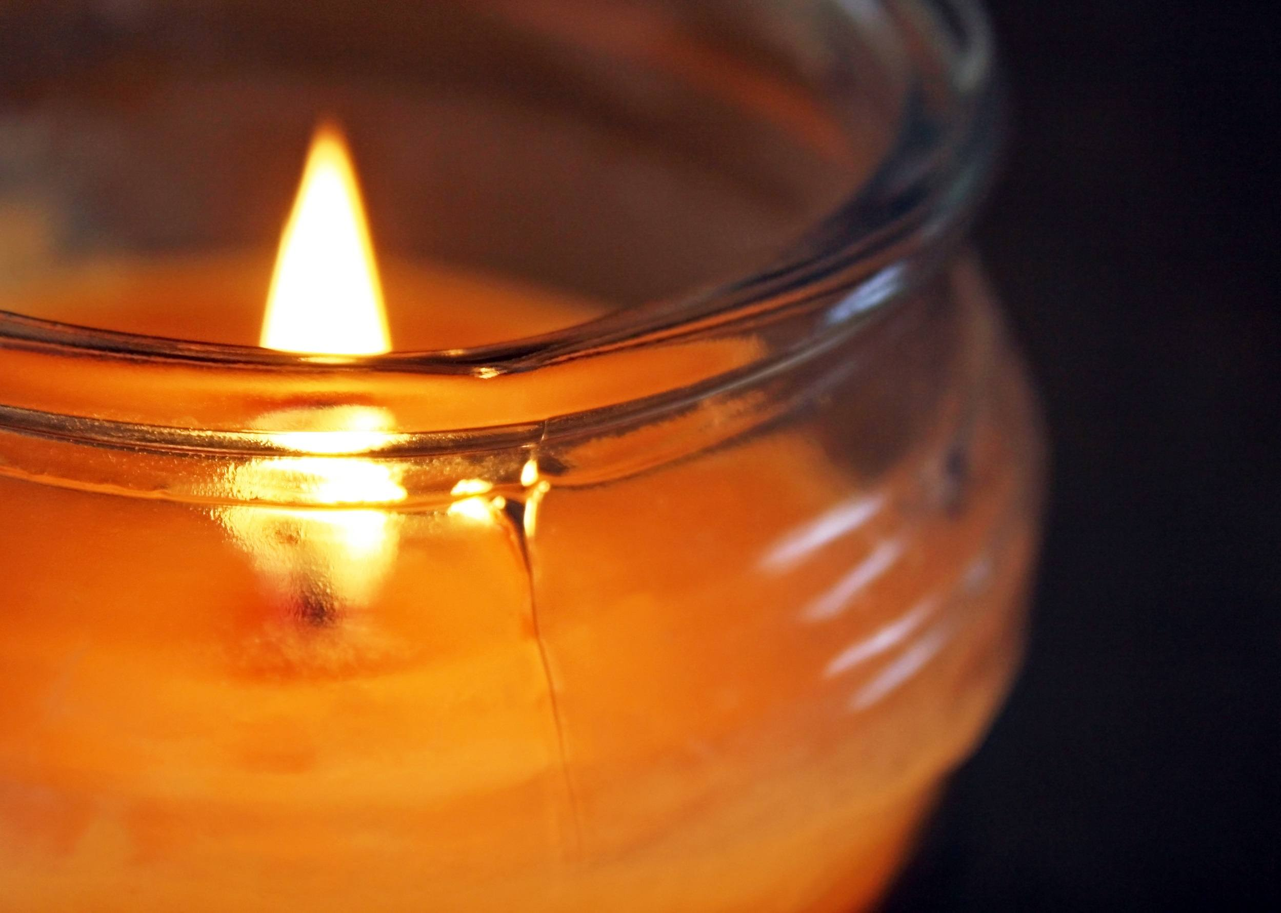 Candle burning in a glass jar