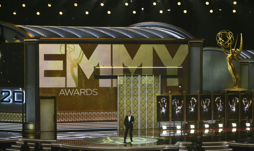 Stephen Colbert stands on the Emmys stage