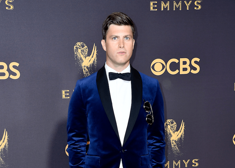 Colin Jost poses in a blue velvet tux at the 2017 Emmys