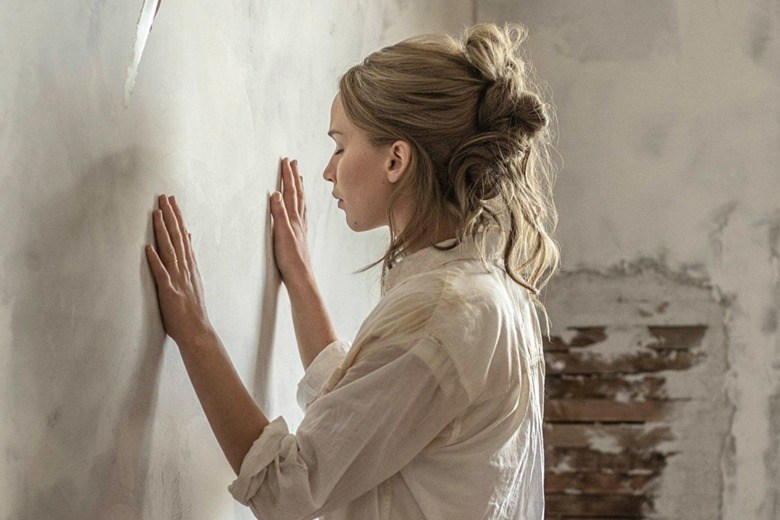 Jennifer Lawrence lays his hand against a wall in mother!