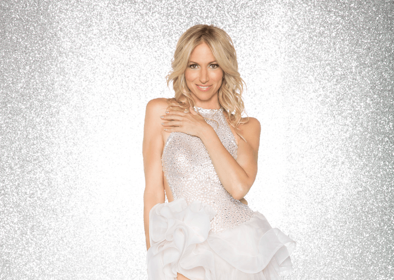 Debbie Gibson poses in a sparkly silver dress