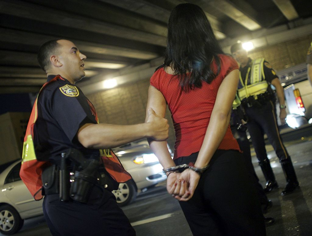 Woman getting arrested for a DUI