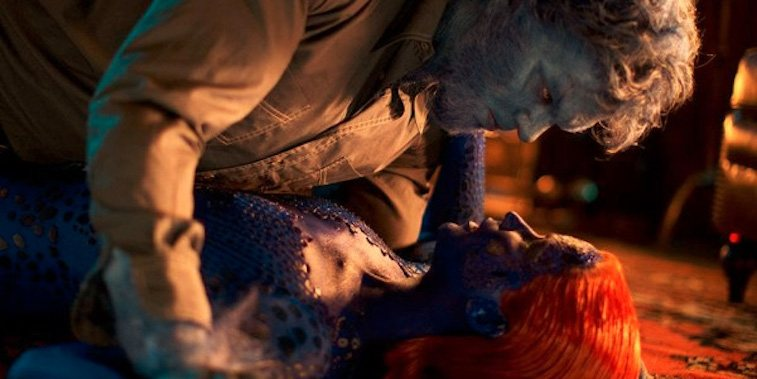 Beast holds himself over Mystique on the ground