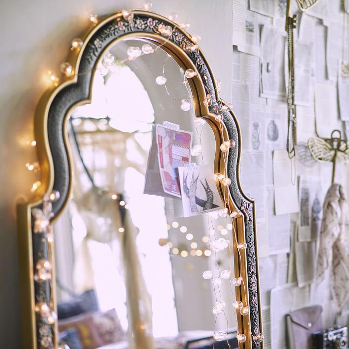 Elaborate arched mirror