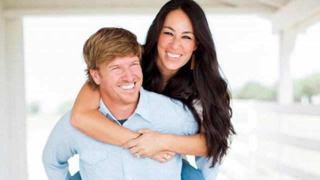 Chip and Joanna Gaines posing for photos and laughing.