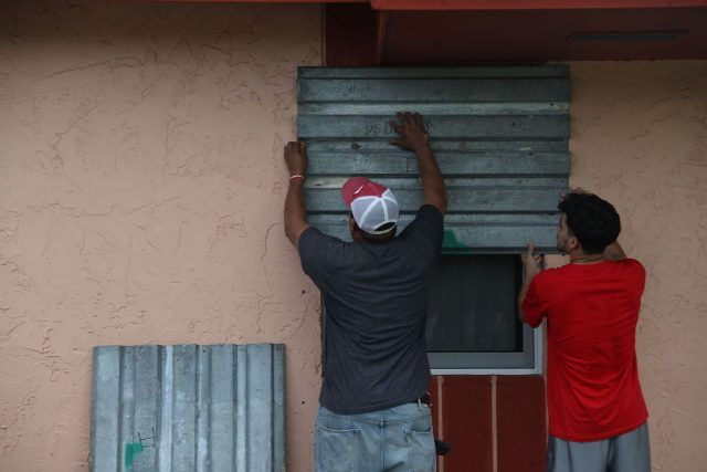 Residents board up their windows.