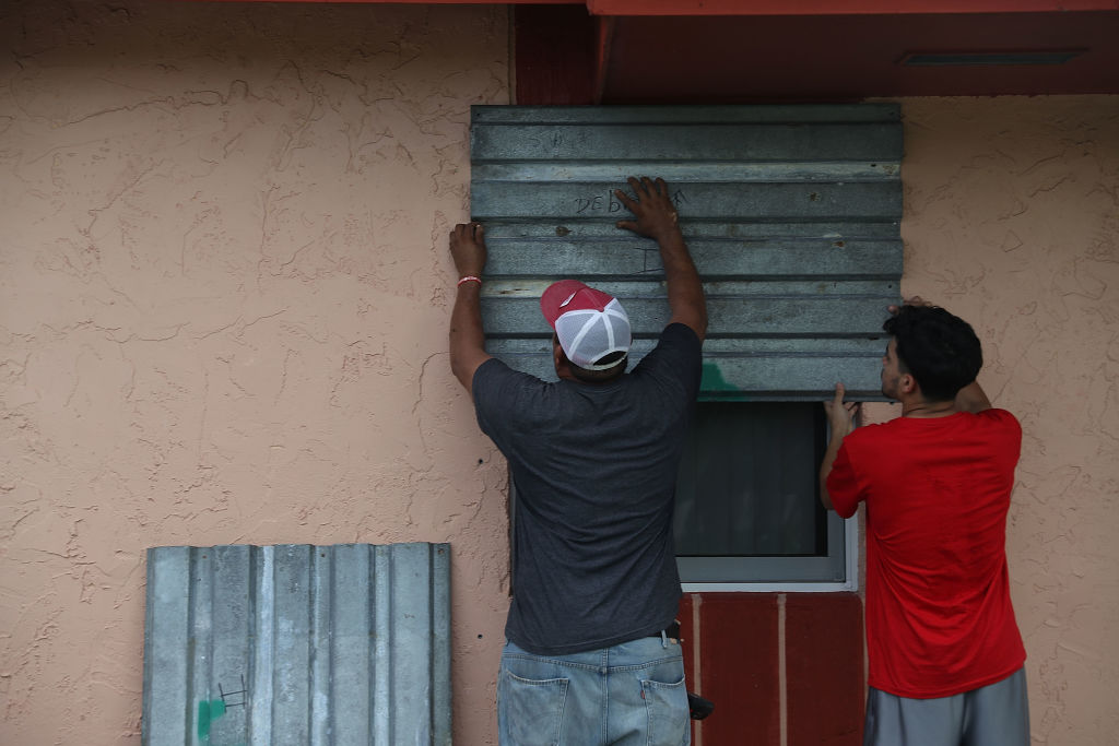 Residents board up their windows